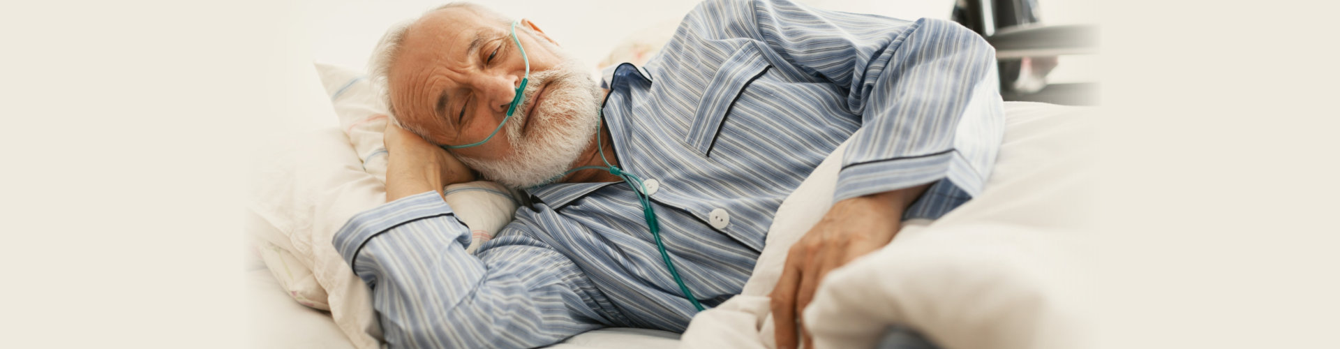 Older sick man with a oxygen mask lying