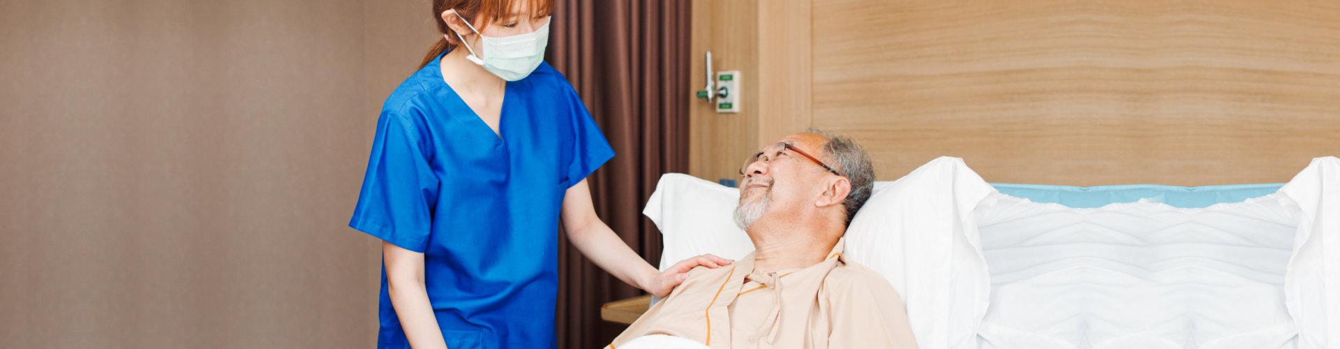 Female Asian nurse wear mask care and check on senior